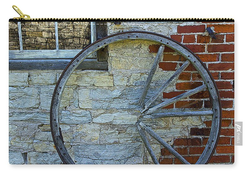 Wagon Wheel Carry-all Pouch featuring the photograph Broken Wagon Wheel Against The Wall by Randall Nyhof
