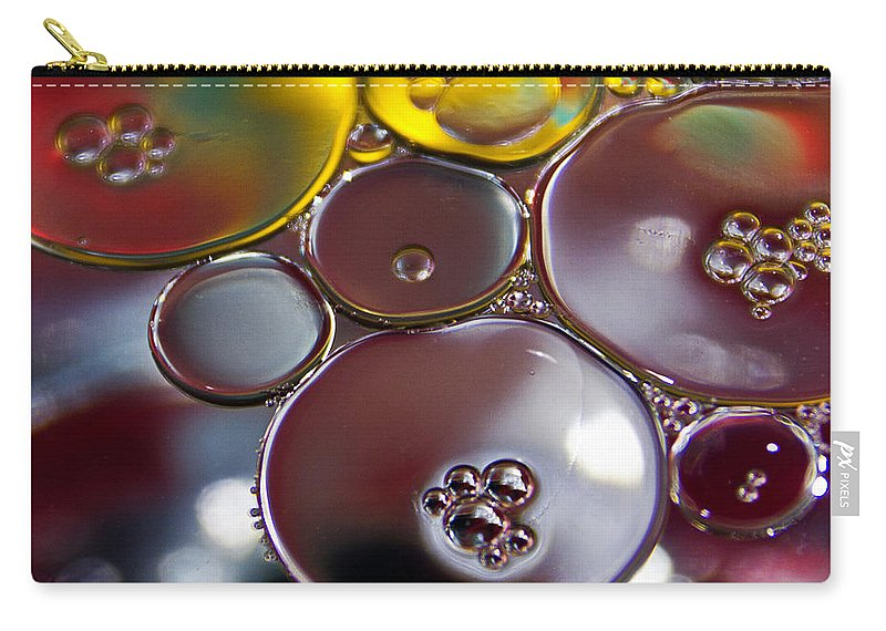Bubbles Carry-all Pouch featuring the photograph Bubbles Iv by David Pringle