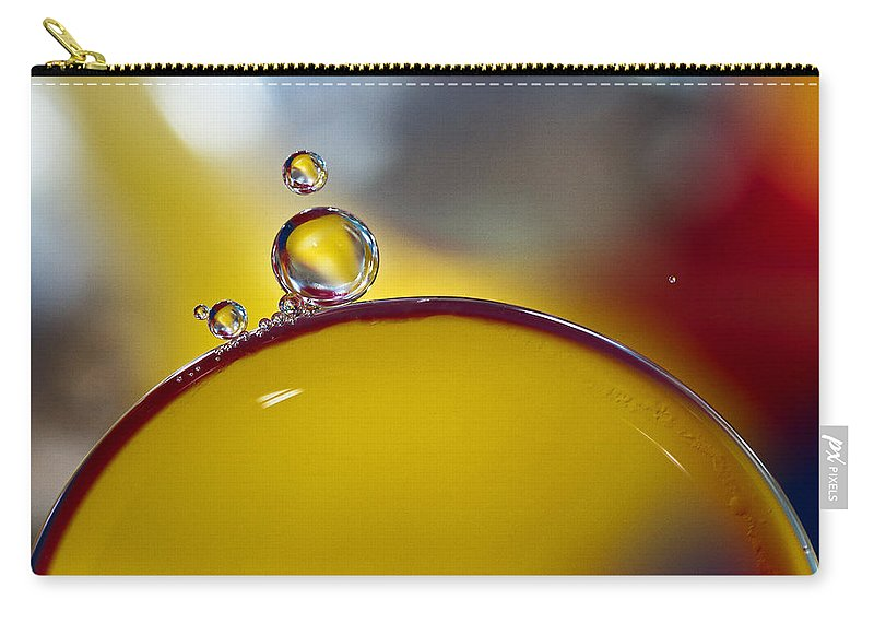 Bubbles Carry-all Pouch featuring the photograph Bubbles Vi by David Pringle