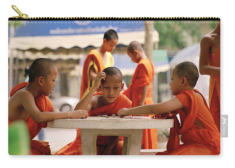 Wat Carry-all Pouch featuring the photograph Buddhist Childhood by Shaun Higson