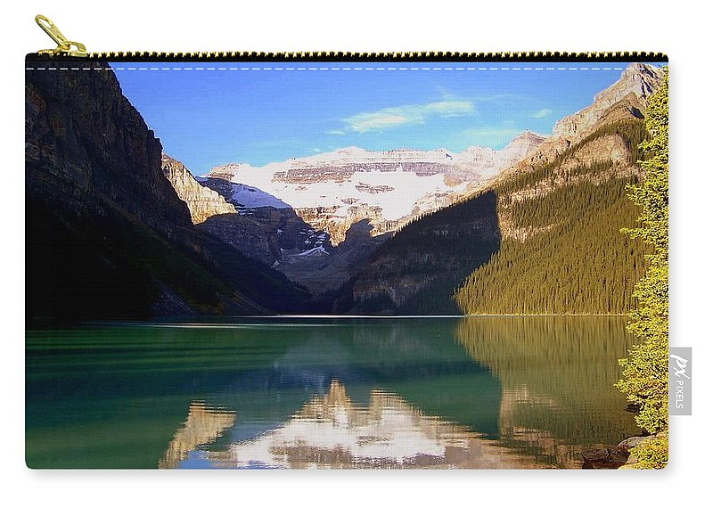 Lake Louise Carry-all Pouch featuring the photograph Butterfly Phenomenon At Lake Louise by Karen Wiles