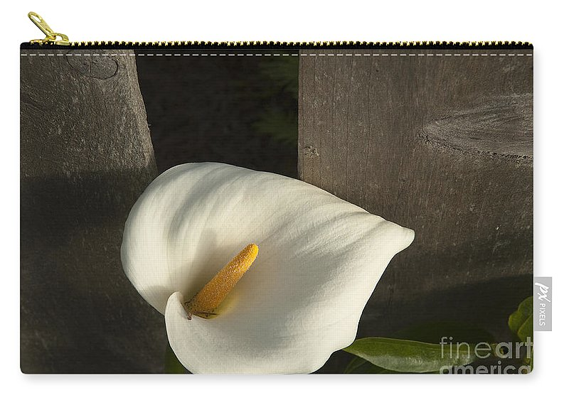 Sandra Bronstein Carry-all Pouch featuring the photograph Calla Lily And Fence by Sandra Bronstein