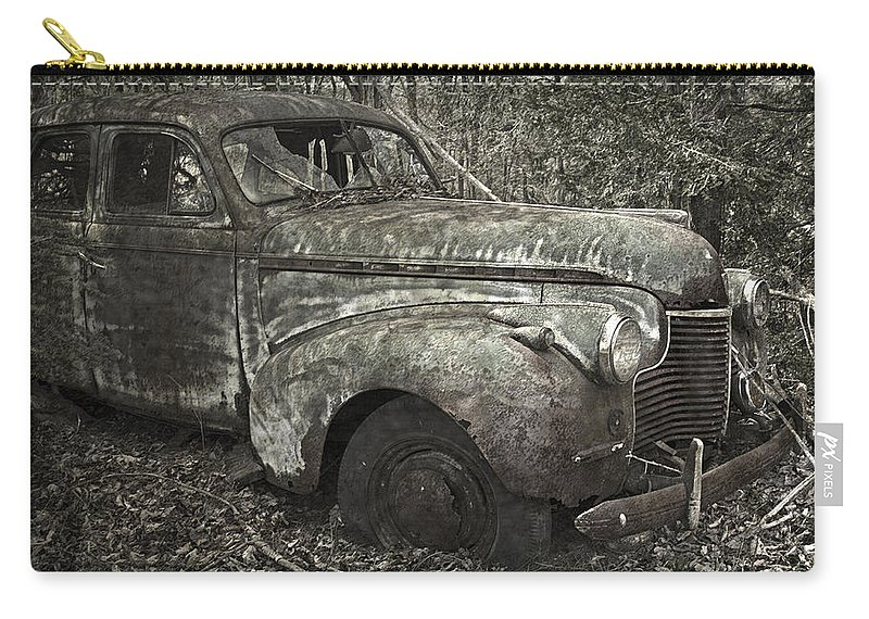 Rustbuckets Carry-all Pouch featuring the photograph Camouflage Classic Car by John Stephens