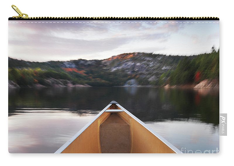 Canoe Carry-all Pouch featuring the photograph Canoeing In Ontario Provincial Park by Oleksiy Maksymenko
