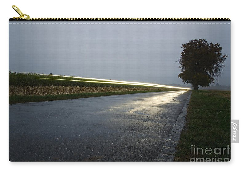 Car Carry-all Pouch featuring the photograph Car Lights On The Street by Mats Silvan