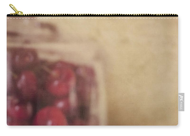 Cherry Carry-all Pouch featuring the photograph Cerise by Priska Wettstein