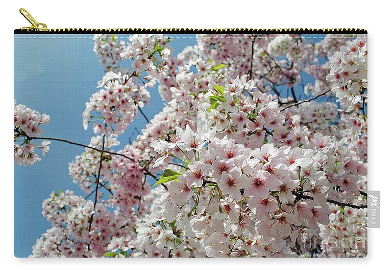 Cherry Carry-all Pouch featuring the photograph Cherry Blossoms Of The Sky by Jost Houk