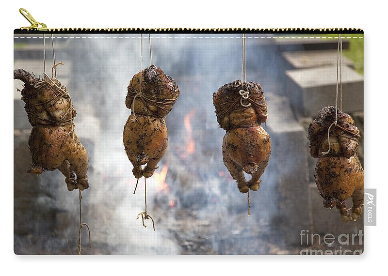 Roasted Chicken Carry-all Pouch featuring the photograph Chickens Roasting On Open Pit Fire by John Stephens
