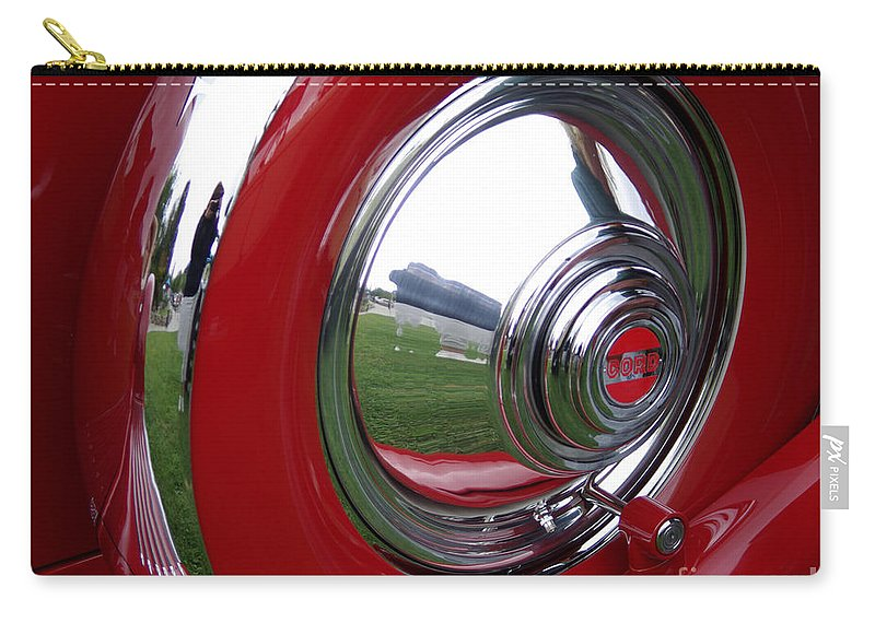Cord Carry-all Pouch featuring the photograph Cord Hubcap by Jim And Emily Bush