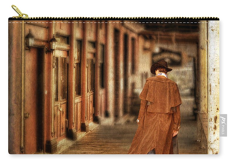 Cowboy Boots Carry-all Pouch featuring the photograph Cowboy In Old West Town by Jill Battaglia