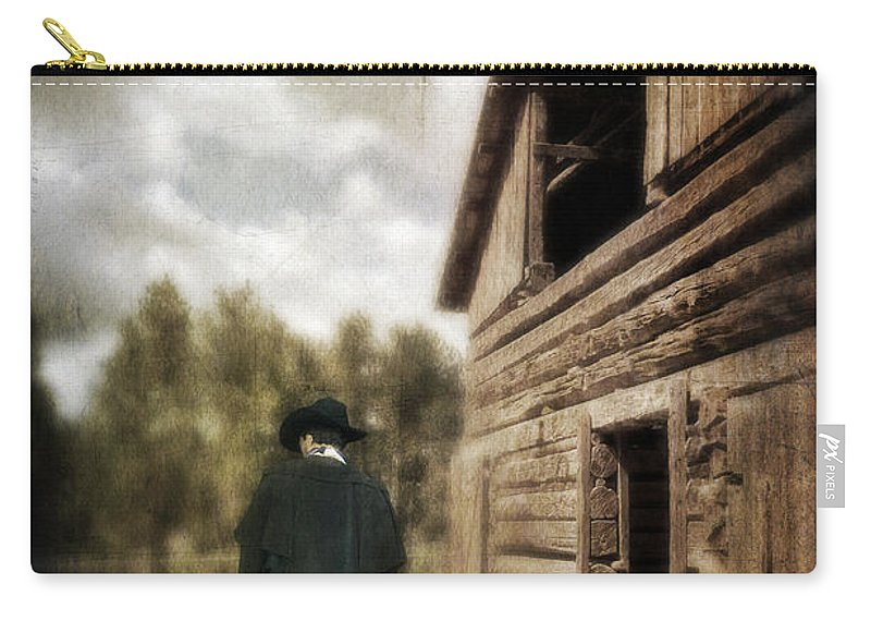 Cowboy Boots Carry-all Pouch featuring the photograph Cowboy Walking By Barn by Jill Battaglia