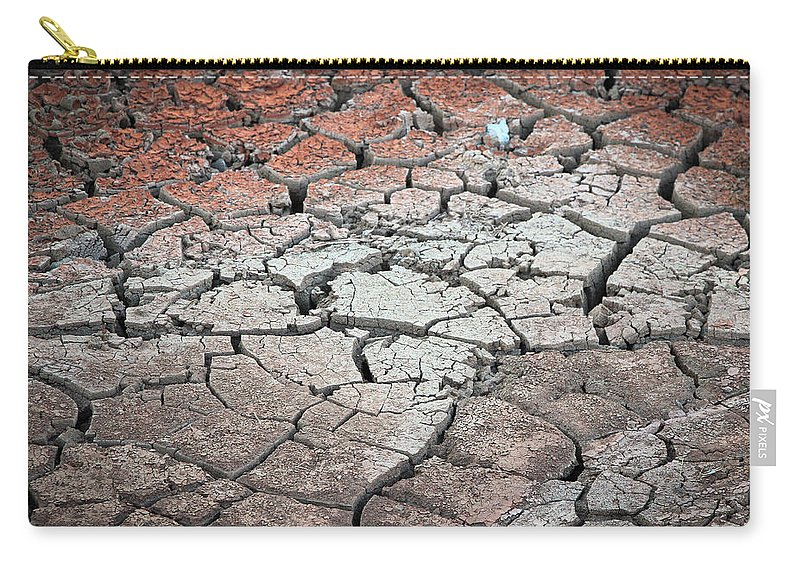 Desert Carry-all Pouch featuring the photograph Cracked Earth by Athena Mckinzie