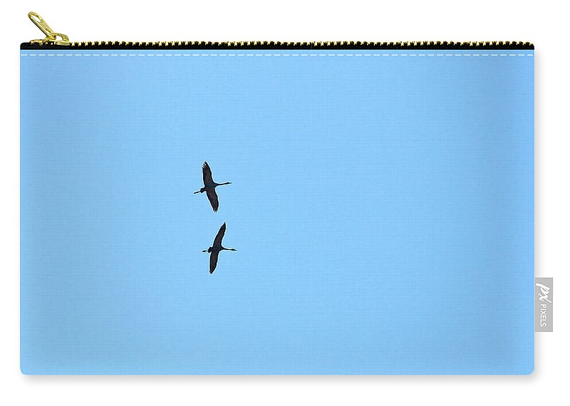 Isosuo Carry-all Pouch featuring the photograph Cranes by Jouko Lehto