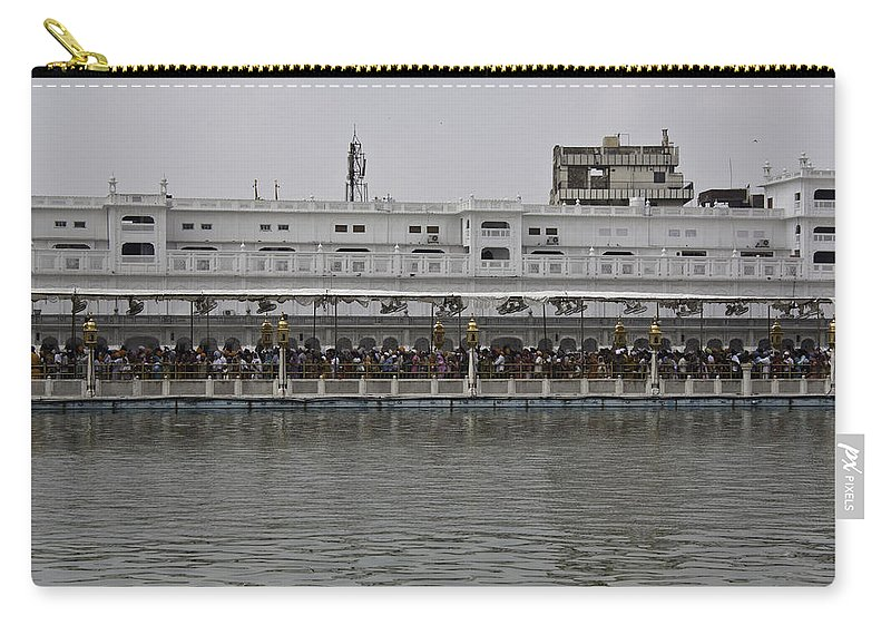 Amrit Sarovar Carry-all Pouch featuring the photograph Crowd Of Devotees Inside The Golden Temple by Ashish Agarwal
