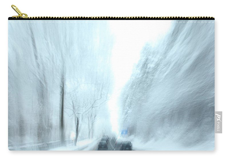 Driving Carry-all Pouch featuring the photograph Cruising In A Snowstorm by Karol Livote