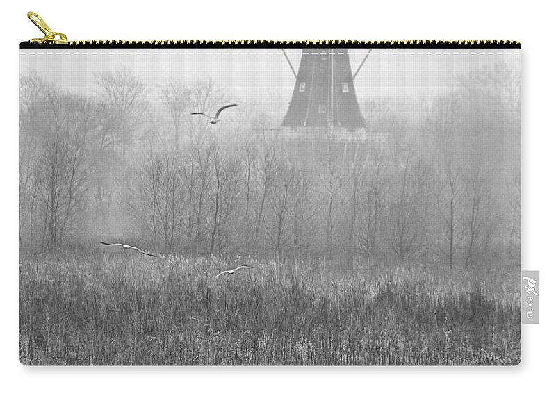 Art Carry-all Pouch featuring the photograph Dezwaan Windmill On A Foggy Morning In March by Randall Nyhof