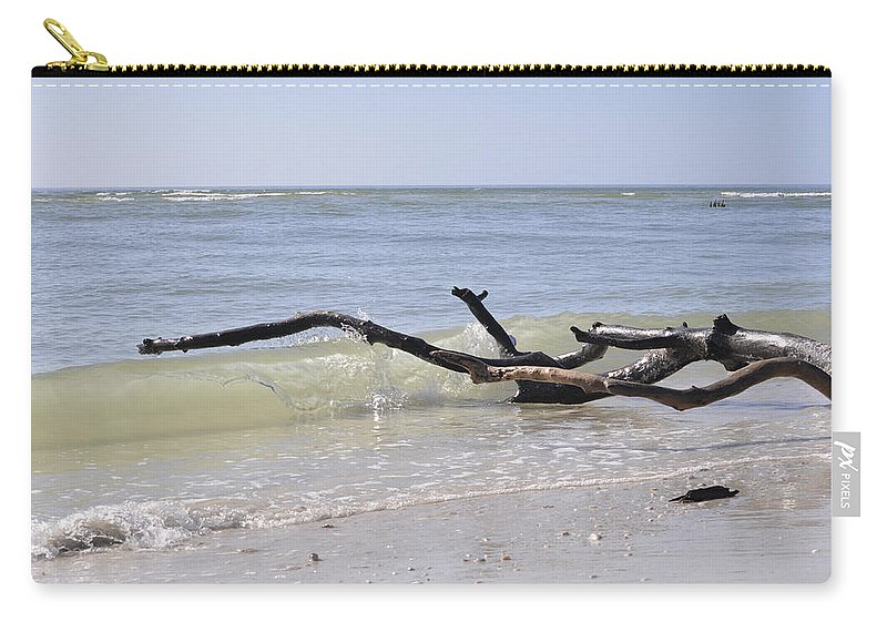 Driftwood Carry-all Pouch featuring the photograph Driftwood In The Surf by Christine Stonebridge