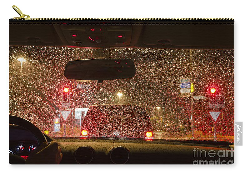 Car Carry-all Pouch featuring the photograph Driving A Car At Night by Mats Silvan