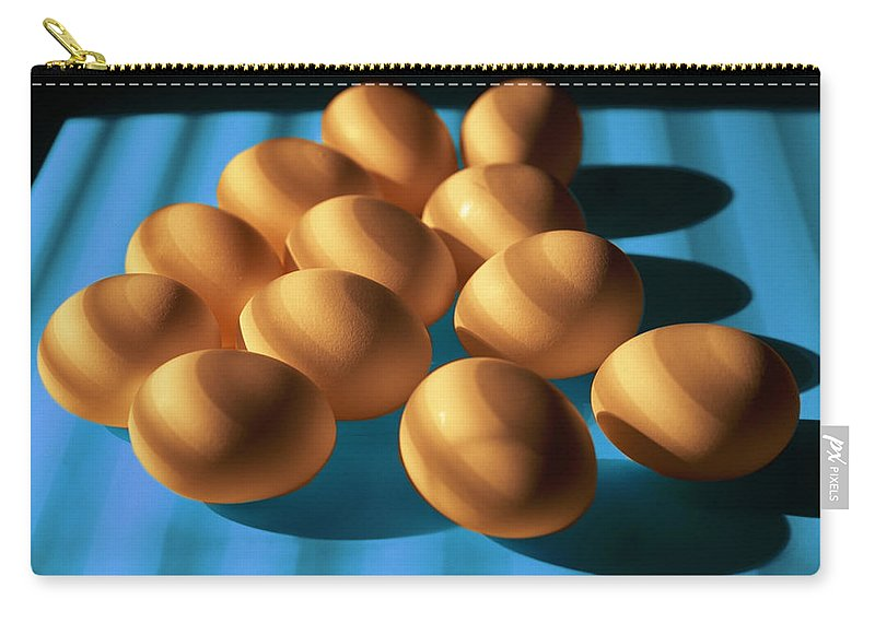 Art Carry-all Pouch featuring the photograph Eggs On Blue Lit Through Venetian Blinds by Randall Nyhof