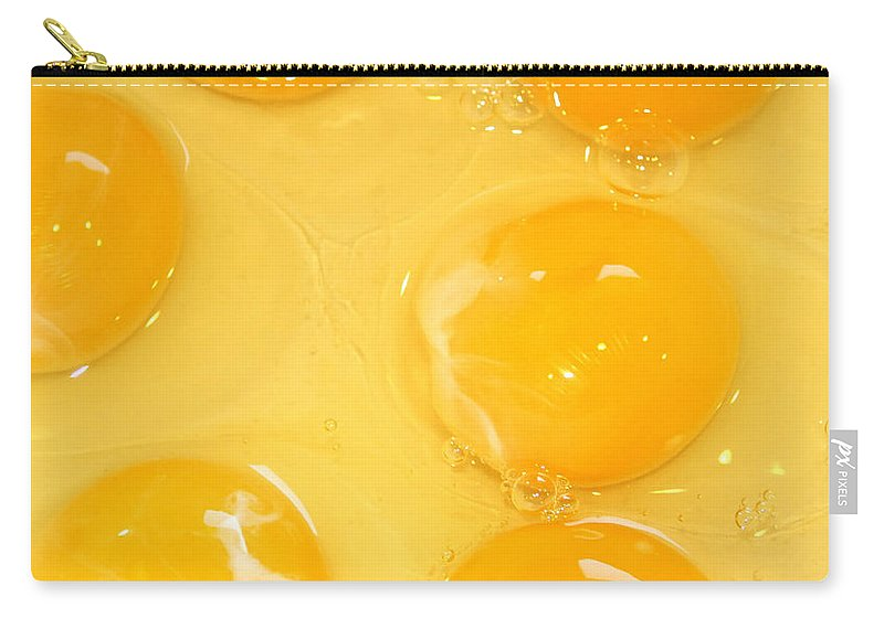 Egg Carry-all Pouch featuring the photograph Eggs Yolk by Henrik Lehnerer