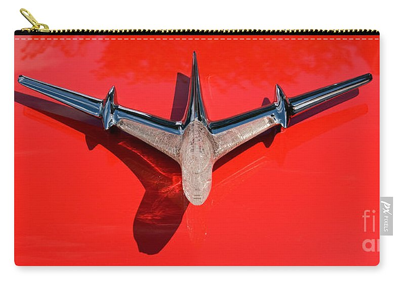 Car Carry-all Pouch featuring the photograph Emblem On Red 2 by Vivian Christopher