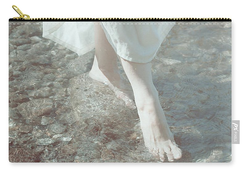 Female Carry-all Pouch featuring the photograph Feet In Water by Joana Kruse