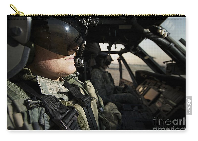 Helicopter Carry-all Pouch featuring the photograph Female Pilot Commander In The Cockpit by Terry Moore
