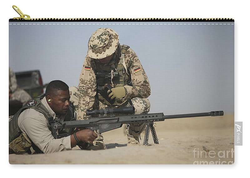 Operation Enduring Freedom Carry-all Pouch featuring the photograph Fijian Contractor Clearing His Barrett by Terry Moore