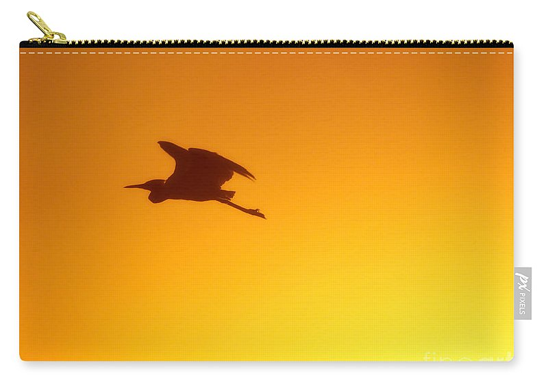 Bird Carry-all Pouch featuring the photograph Flight by Joan McCool