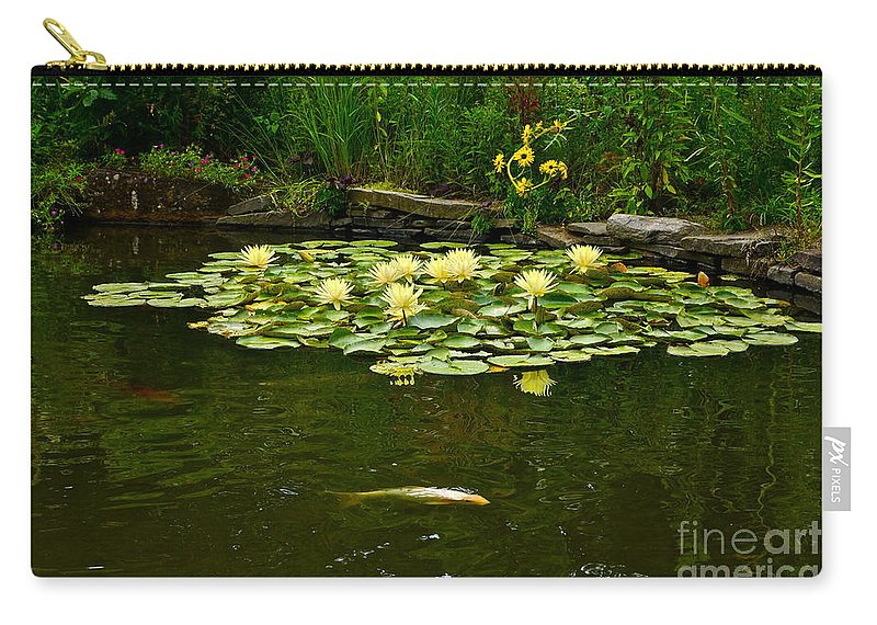 Koi And Waterlilies Carry-all Pouch featuring the photograph Flowers And Koi by Byron Varvarigos