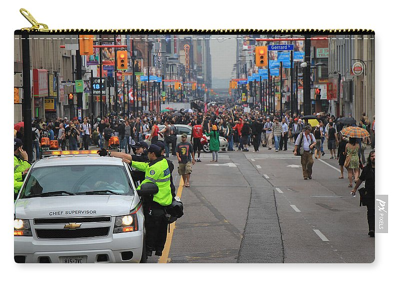 Toronto Carry-all Pouch featuring the photograph G20 Summit Toronto by Andrew Fare