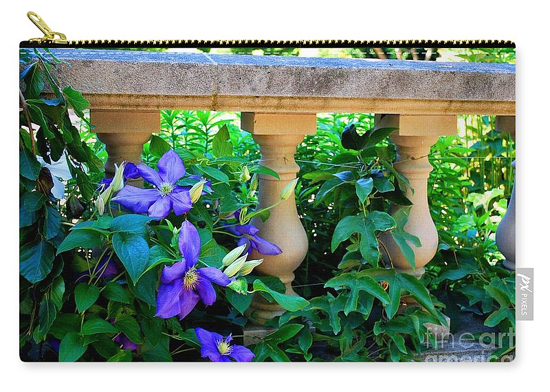 Sculpture Carry-all Pouch featuring the photograph Garden Wall With Periwinkle Flowers by Nancy Mueller