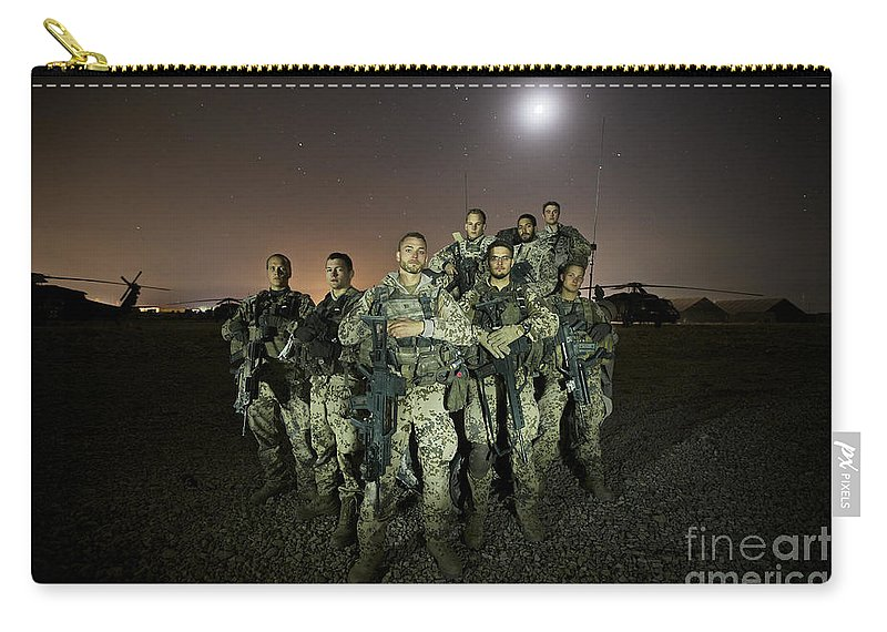 Provincial Reconstruction Team Carry-all Pouch featuring the photograph German Army Crew Poses by Terry Moore
