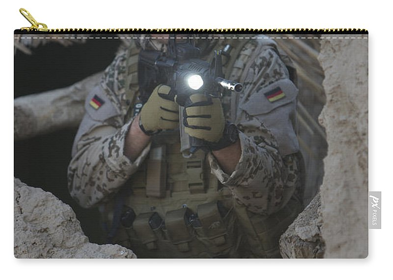 Operation Enduring Freedom Carry-all Pouch featuring the photograph German Army Soldier Armed With A M4 by Terry Moore