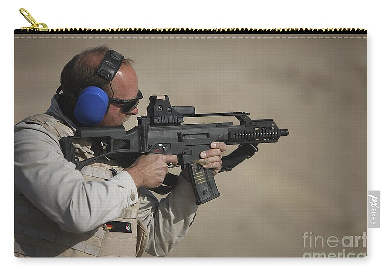 Isaf Carry-all Pouch featuring the photograph German Police, Isaf Member Fires A G36k by Terry Moore