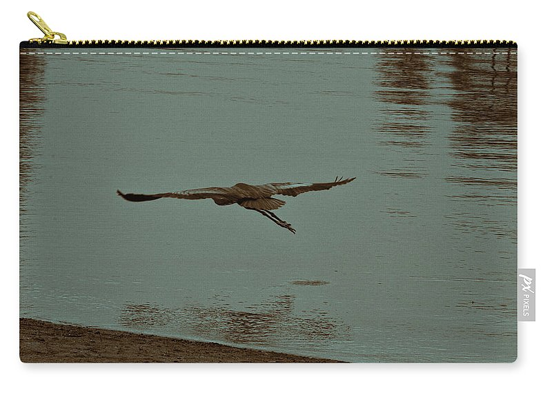 Blue Heron Carry-all Pouch featuring the photograph Gliding Inches Above The Water by Douglas Barnard