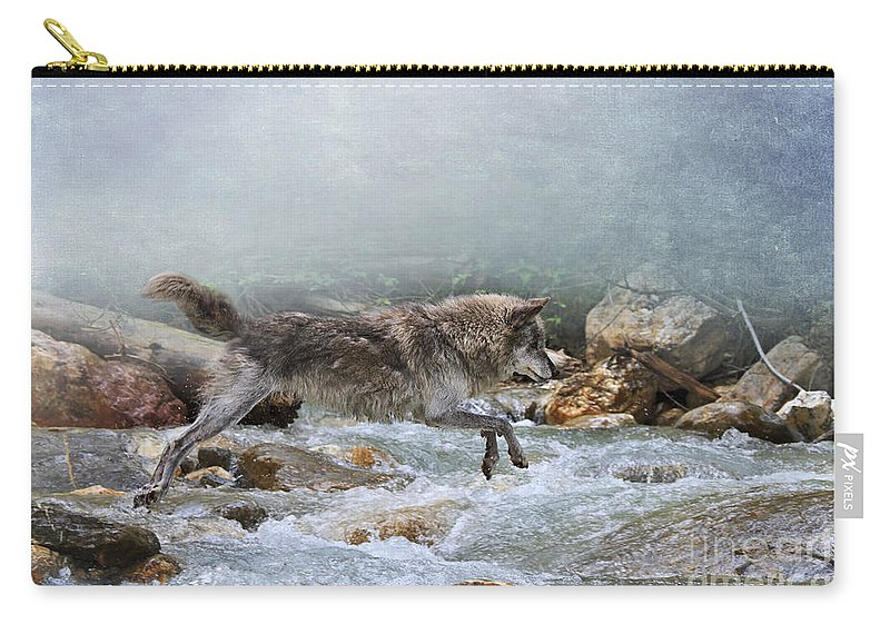 Wolf Carry-all Pouch featuring the photograph Grey Wolf Jumping Over A Mountain Stream by Louise Heusinkveld