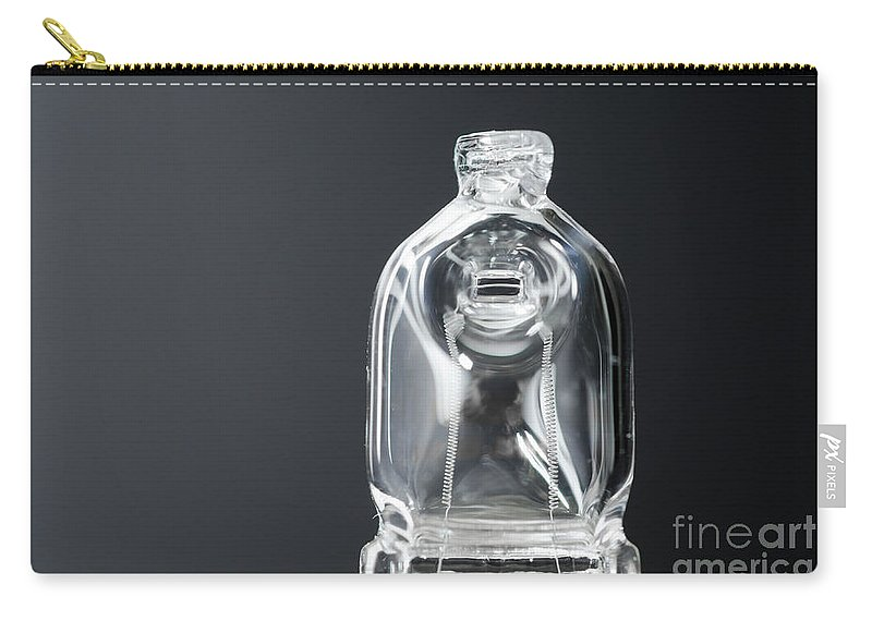 Halogen Carry-all Pouch featuring the photograph Halogen Lamp by Mats Silvan
