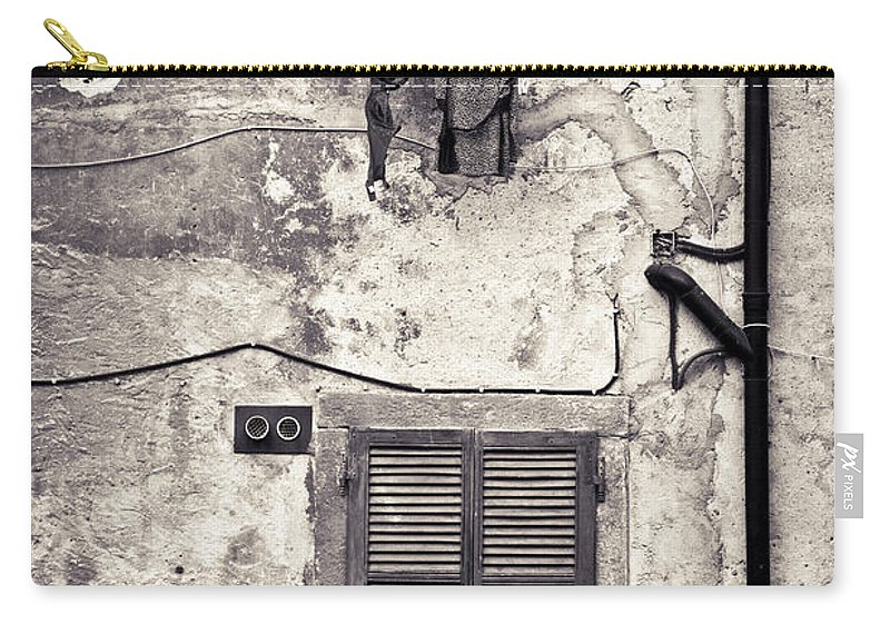Washing Carry-all Pouch featuring the photograph Hanging Out To Dry by Silvia Ganora