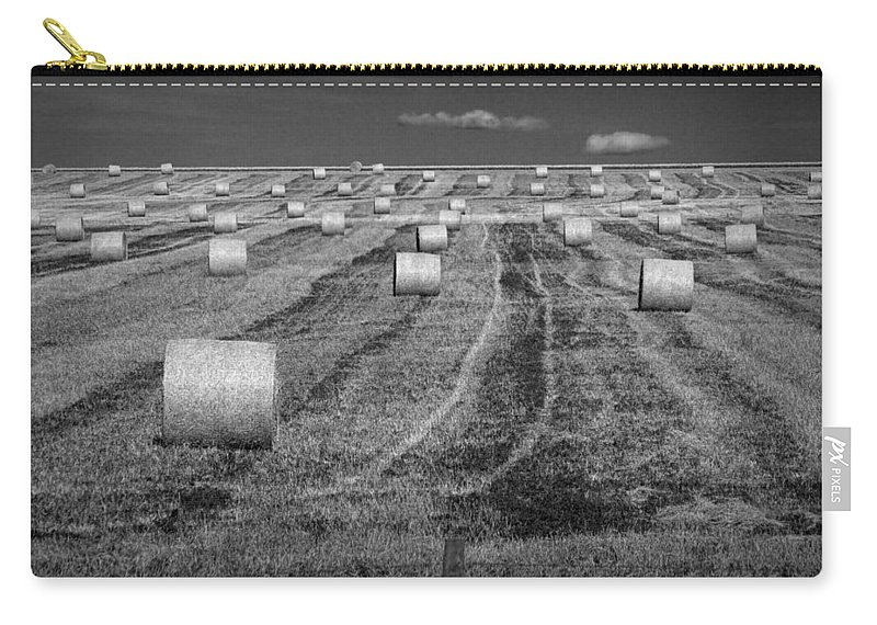 Art Carry-all Pouch featuring the photograph Hay Bales On A Farm In Alberta by Randall Nyhof