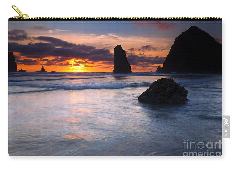 Haystack Rock Carry-all Pouch featuring the photograph Haystack Sunset by Mike Dawson