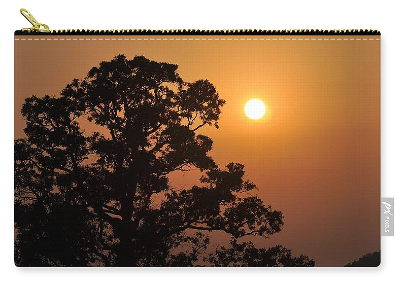 Sunset Carry-all Pouch featuring the photograph Hazy Sunset by Marty Koch