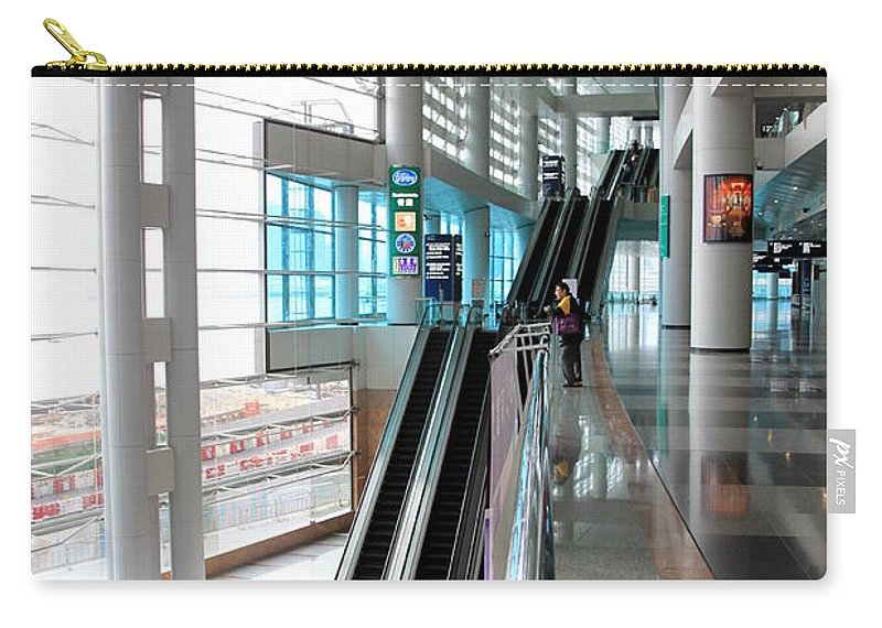 Skyscraper Carry-all Pouch featuring the photograph Hong Kong Convention And Exhibition Centre by Valentino Visentini