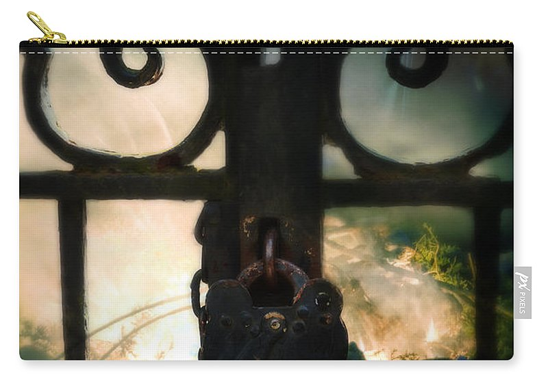 Fire Carry-all Pouch featuring the photograph Hooded Figure By A Fire by Jill Battaglia