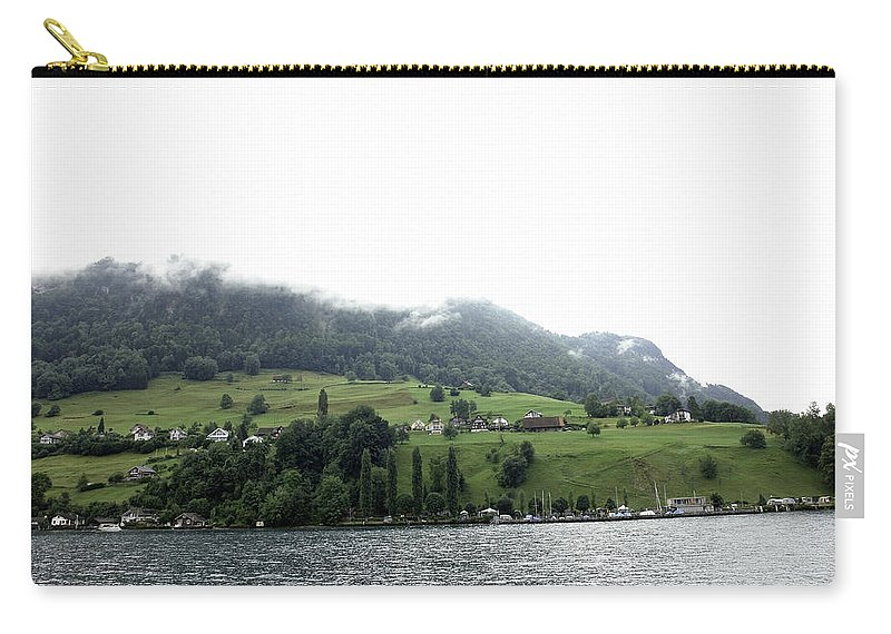 Action Carry-all Pouch featuring the photograph Houses On The Greenery Of The Slope Of A Mountain Next To Lake Lucerne by Ashish Agarwal