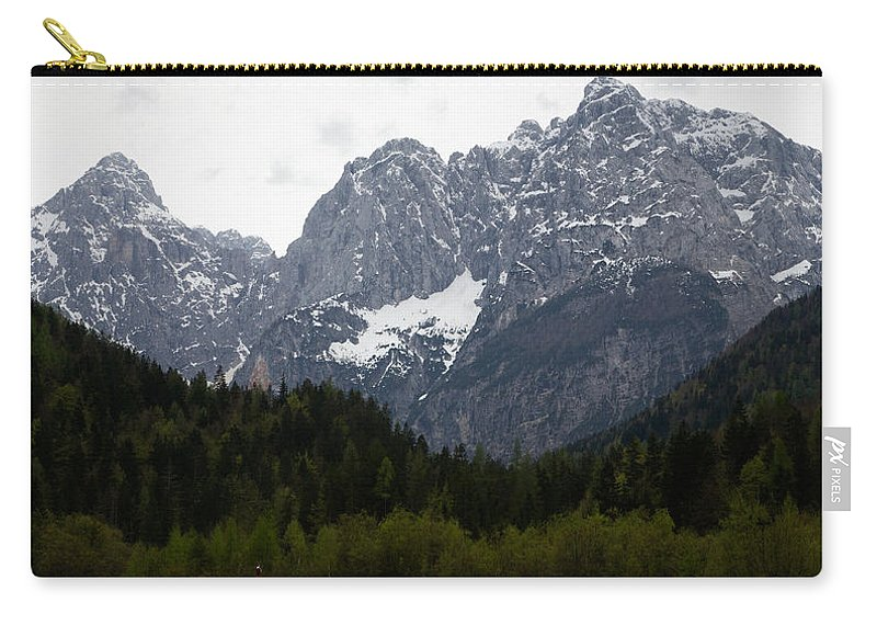 Kranjska Gora Carry-all Pouch featuring the photograph Insignificent by Ian Middleton