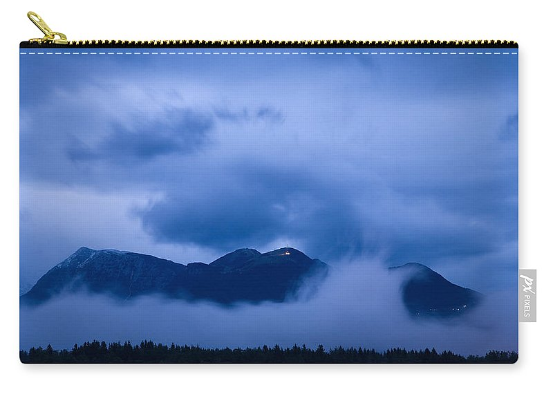 Krvavec Carry-all Pouch featuring the photograph Krvavec Breaks Through After The Rain by Ian Middleton