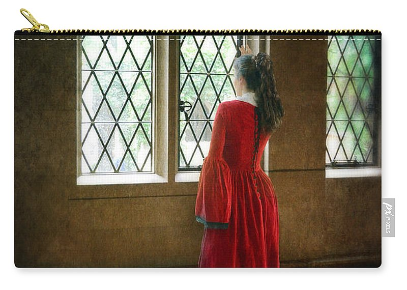 Woman Carry-all Pouch featuring the photograph Lady In Tudor Gown Looking Out A Window by Jill Battaglia