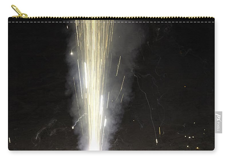 Action Carry-all Pouch featuring the photograph Large Amount Of Sparks From A Conical Firecracker During Diwali by Ashish Agarwal