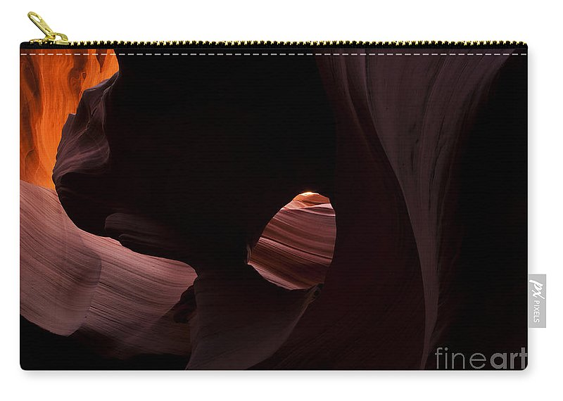 Eye Of The Needle Carry-all Pouch featuring the photograph Light In The Eye by Mike Dawson